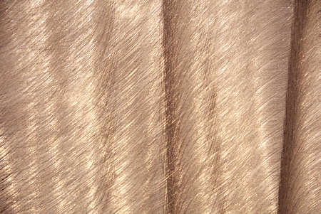 brushed aluminum: bronze tinted aluminum, brushed and rippled Stock Photo