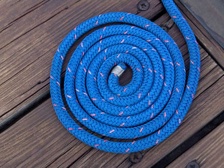 blue boater's rope artistically coiled Stock Photo - 1216023