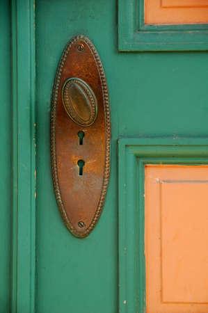 old painted door with metal door handle with key holes