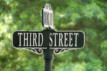 old sign: third street sign at intersection Stock Photo