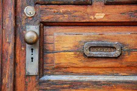 door knob: old wooden door with antique door knob