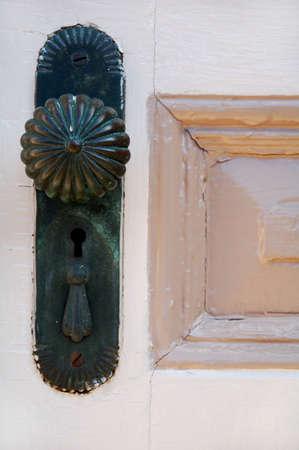 antique doorknob on old wooden door with panel Stock Photo