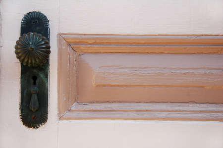 antique doorknob with panel on old door Stock Photo