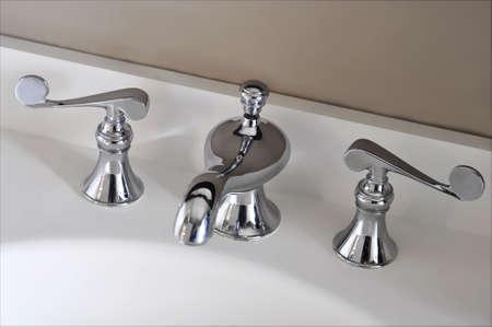silver bathroom faucet Stock Photo