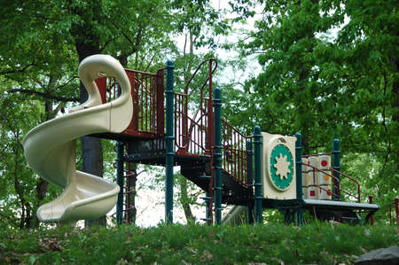outdoor childrens playset in wooded area