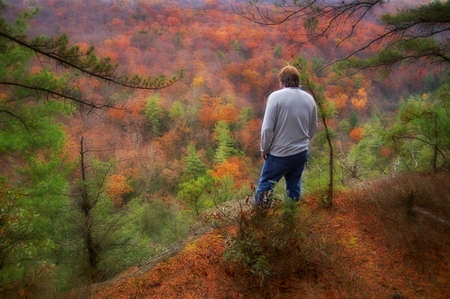 man standing in the colorful autumn hills of West Virginia