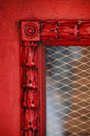 antique trim around window of old door