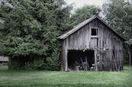 old deteriorating barn in the summer Stock Photo