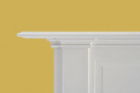 simplistic white fireplace mantle against yelllow wall Banco de Imagens - 42628252