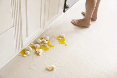 Humorous man splattered eggs on floor when cooking