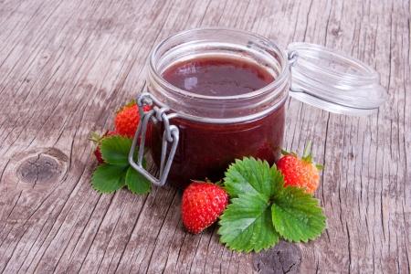 Jar of strawberry jam on vintage wood background Stock Photo - 18748300