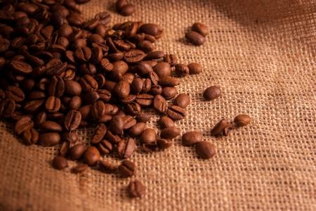 Coffeee beans on jute vintage background