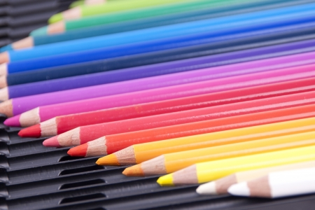 Colored pencils isolated on a black box Stock Photo