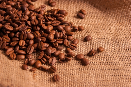 Coffee beans on jute background