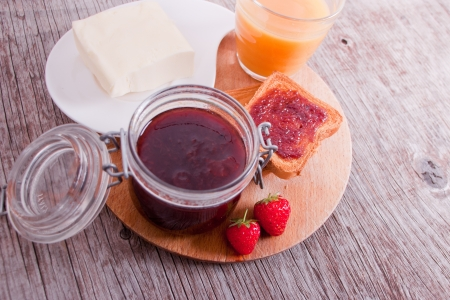 Italian breakfast with jam, strawberies, butter and juice
