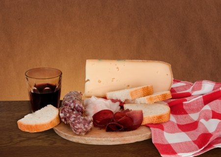 Typical italian appetizer with wine and salami