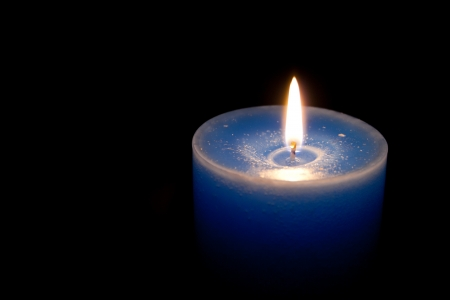 Blue candle in the dark