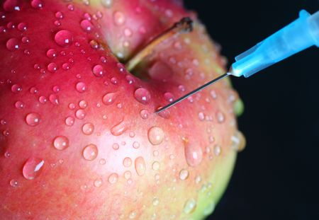 genetically: Apple injection. genetically modified foods.