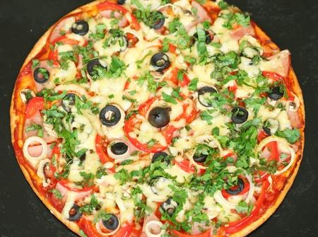 Hot homemade pizza on baking sheet photo