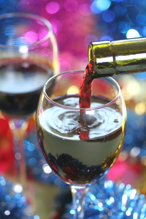 Red wine pouring photo