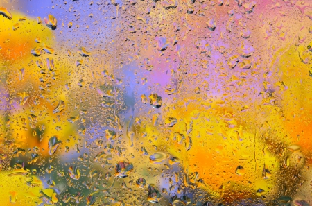 torrential: Close-up of small drops on rainy window. Abstract background. Stock Photo