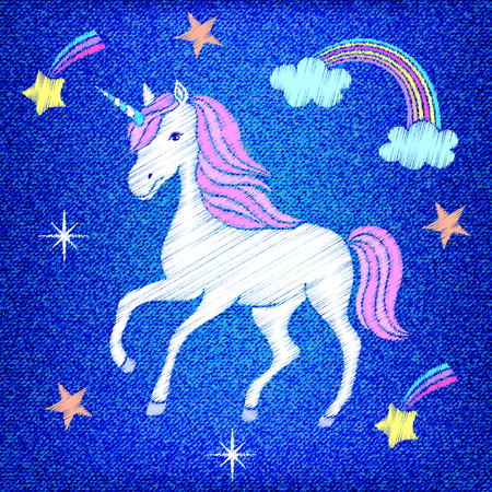 Embroidered unicorn design on jeans texture.