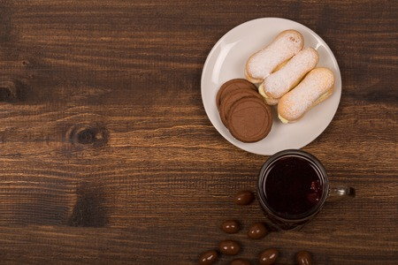 hardwoods: Cup of tea and cookies on the table. Top view Stock Photo