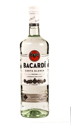 READING MOLDOVA APRIL 7, 2016. bottle of Bacardi rum with a empty glass of ice.