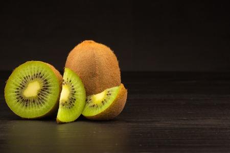 Kiwi fruit on brown wooden background Stock Photo