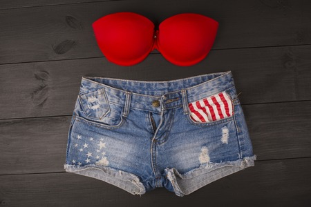 brassiere: Womans brassiere top and jeans shorts. top view Stock Photo