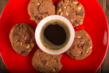 amaretto: Coffee cup and amaretti biscuits on wooden background. top view