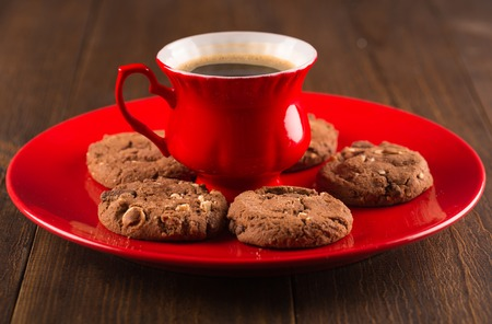 biscuits: Coffee cup and amaretti biscuits on wooden background. Stock Photo