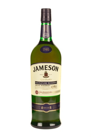 produced: READING MOLDOVA APRIL 7, 2016. Jameson whiskey isolated on white background. Jameson is blended Irish whiskey produced by the Irish Distillers subsidiary of Pernod Ricard since 1780.