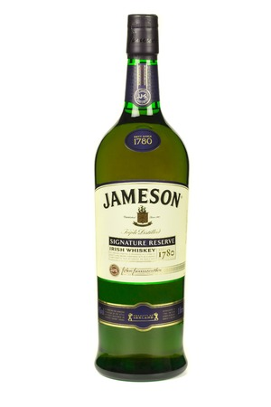 distillers: READING MOLDOVA APRIL 7, 2016. Jameson whiskey isolated on white background. Jameson is blended Irish whiskey produced by the Irish Distillers subsidiary of Pernod Ricard since 1780.