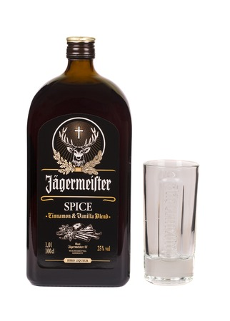 illustrative material: READING MOLDOVA APRIL 7, 2016: Glass bottle of Jagermeister spice dark liquor. Jagermeister is a german digestif made with herbs and spices. Editorial