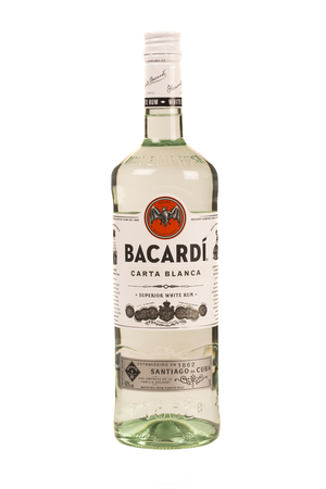 bacardi: READING MOLDOVA APRIL 7, 2016. bottle of Bacardi rum with a empty glass of ice.