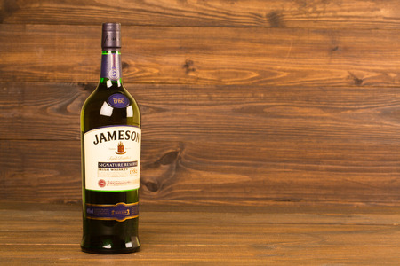 distilled: READING MOLDOVA APRIL 8, 2016. One bottle of Jameson Whiskey Triple Distilled 40% 1 Liter on black background. Blended whiskey is imported from Ireland