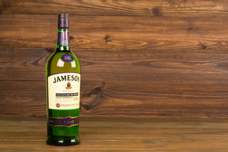 liter: READING MOLDOVA APRIL 8, 2016. One bottle of Jameson Whiskey Triple Distilled 40% 1 Liter on black background. Blended whiskey is imported from Ireland