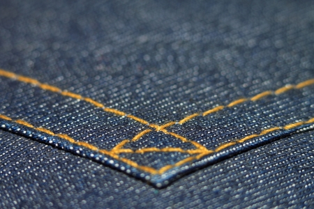 Seam jeans fabric macro close up with background photo