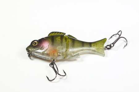 Fake bait for fishing with white background photo