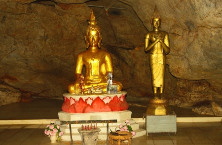 Statue of Buddha in the cavern of Wat tumpasaby temple in Thailand photo