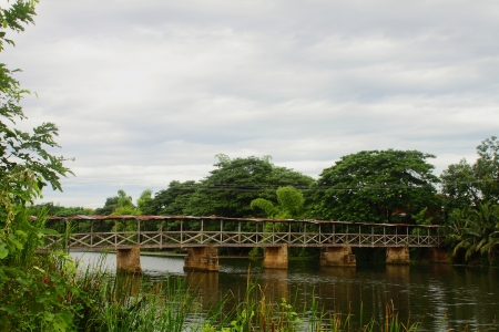 Old wooden bridge across the river photo