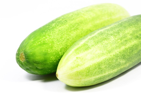 Fresh cucumber with white background photo