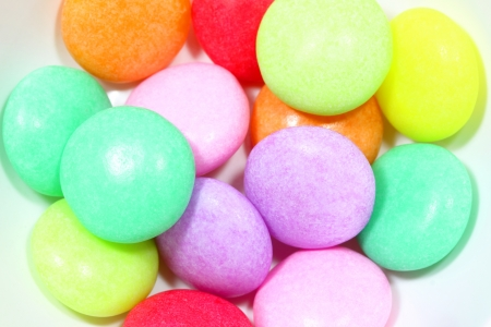 Colorful chewy candy with white background photo