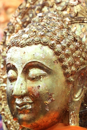 Face of golden Buddha photo