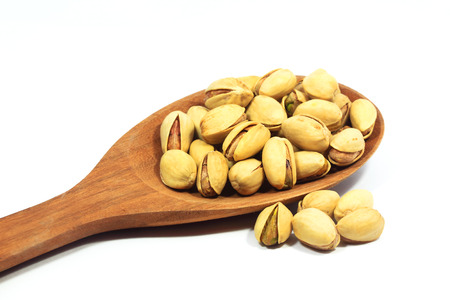 Pistachios with white background photo