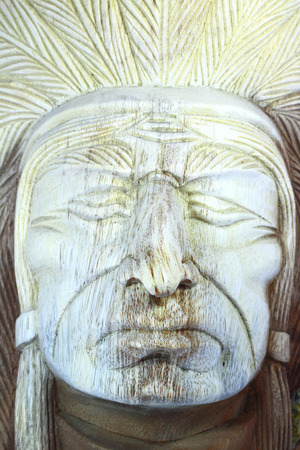 Wood carving of Face Indian apache Stock Photo