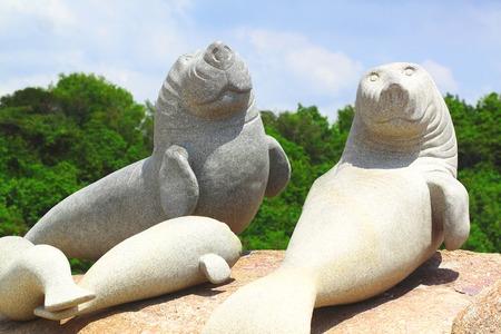 Stone carving dugongs at rayong Thailand photo
