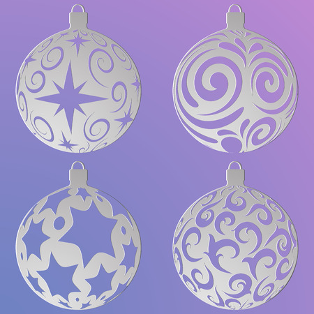 Christmas balls set with a snowflakes and curls , cut out of paper, isolated