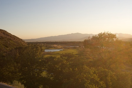 view from above of golf course with bright sunshine from side Stock Photo